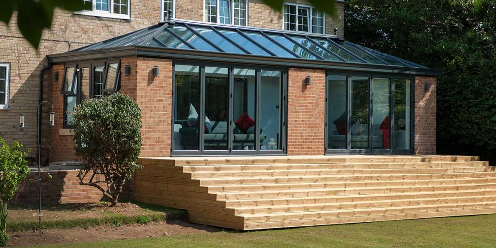 Large Modern Orangery with Grey Bi-Folds